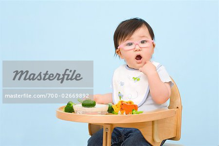 Baby Eating in Highchair Stock Photo - Rights-Managed, Image code: 700-02669892
