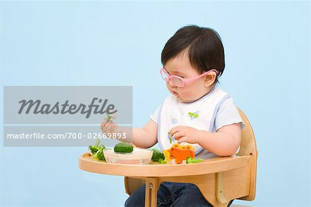 Baby Eating in Highchair Stock Photo - Rights-Managed, Image code: 700-02669893
