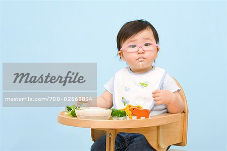 Baby Eating in Highchair Stock Photo - Rights-Managed, Image code: 700-02669894