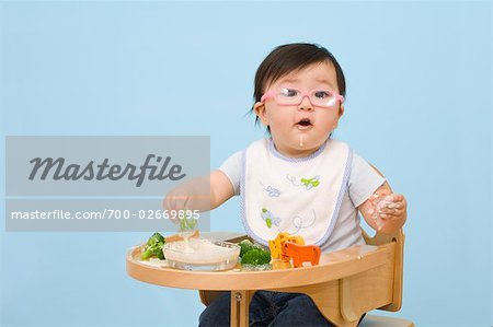 Baby Eating in Highchair Stock Photo - Rights-Managed, Image code: 700-02669895