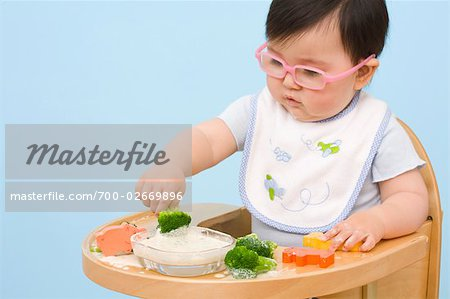 Baby Eating in Highchair Stock Photo - Rights-Managed, Image code: 700-02669896