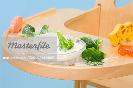Broccoli and Dip on Highchair Tray Stock Photo - Rights-Managed, Image code: 700-02669897