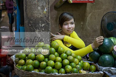 Woman Selling Green Tangerines at Market, Siem Reap, Cambodia Stock Photo - Rights-Managed, Image code: 700-02670081