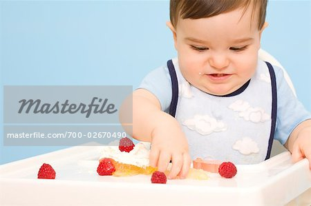 Baby Eating in High Chair Stock Photo - Rights-Managed, Image code: 700-02670490