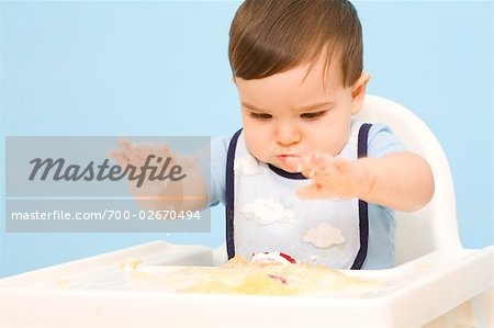 Baby Eating in High Chair Stock Photo - Rights-Managed, Image code: 700-02670494