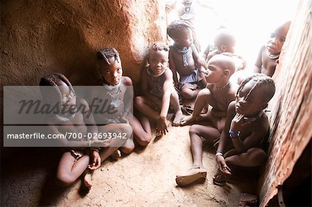 Himba Children Sitting on Floor of Hut, Namibia Stock Photo - Rights-Managed, Image code: 700-02693942