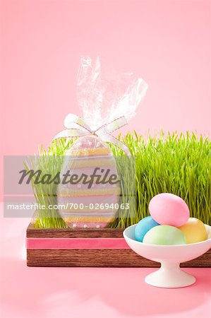 Easter Cookie in Grass Filled Tray with Dish of Dyed Easter Eggs Stock Photo - Rights-Managed, Image code: 700-02694063