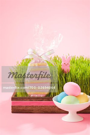 Egg Shaped Easter Cookie in Grass Filled Tray with Marshmallow Bunny and Dish of Dyed Eggs Stock Photo - Rights-Managed, Image code: 700-02694064