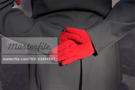 Person in Dress Uniform Wearing Red Gloves Stock Photo - Rights-Managed, Image code: 700-02694067
