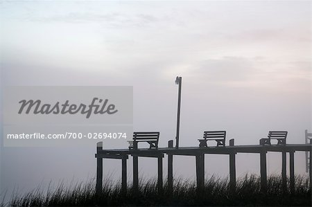 Benches on Pier at Dusk, Chincoteague, Virginia, USA Stock Photo - Rights-Managed, Image code: 700-02694074