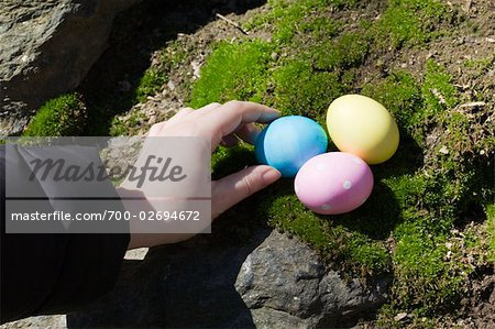 Woman Hiding Easter Eggs Stock Photo - Rights-Managed, Image code: 700-02694672