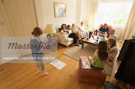 Boy Playing Recorder for Family Stock Photo - Rights-Managed, Image code: 700-02698330