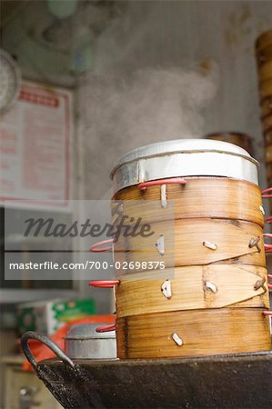 Bamboo Baskets Full of Steamed Dumplings at a Dim Sum Restaurant in Beijing, China