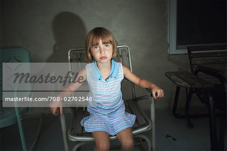 Little Girl Sitting in Lawn Chair Stock Photo - Rights-Managed, Image code: 700-02702548