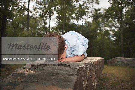 Boy Lying Face Down on Rock