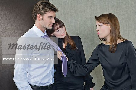 Woman Trying to Grab Man Away From Another Woman Stock Photo - Rights-Managed, Image code: 700-02702772