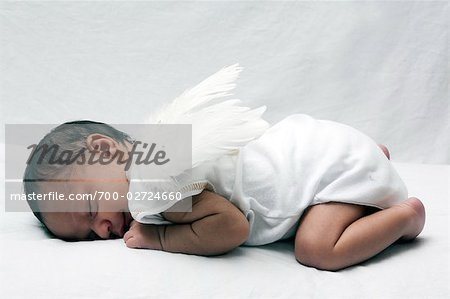 Sleeping Baby with Wings Stock Photo - Rights-Managed, Image code: 700-02724660