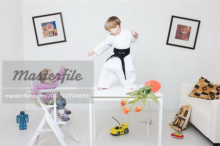 Boy on Table in Karate Pose Stock Photo - Rights-Managed, Image code: 700-02724696