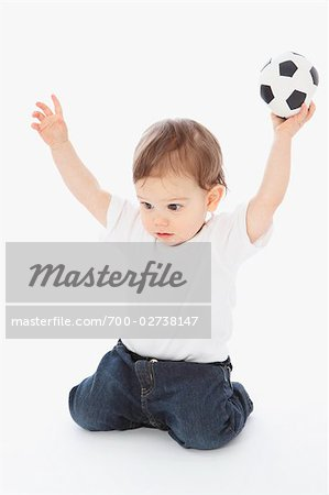 Little Boy Playing With Soccer Ball Stock Photo - Rights-Managed, Image code: 700-02738147