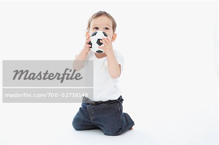 Little Boy Playing With Soccer Ball Stock Photo - Rights-Managed, Image code: 700-02738148