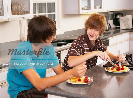 Boys Eating Breakfast Stock Photo - Rights-Managed, Image code: 700-02738784