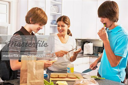 Mother Making School Lunches for Sons Stock Photo - Rights-Managed, Image code: 700-02738843