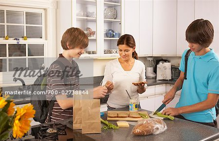Mother Making School Lunches for Sons Stock Photo - Rights-Managed, Image code: 700-02738844
