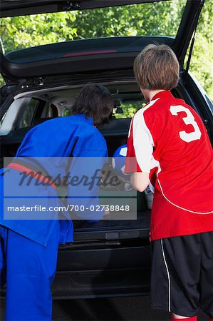 Boys in Karate and Soccer Uniforms Packing the Car Stock Photo - Rights-Managed, Image code: 700-02738848