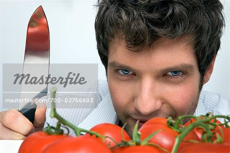 Man With Knife and Tomatoes Stock Photo - Rights-Managed, Image code: 700-02756603
