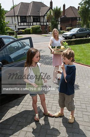 Family Carrying Organic Produce from Car into House Stock Photo - Rights-Managed, Image code: 700-02756846