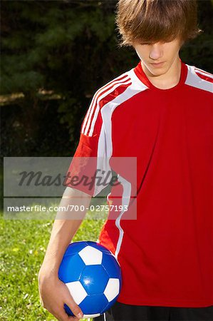 Teenage Boy Holding Soccer Ball Stock Photo - Rights-Managed, Image code: 700-02757193
