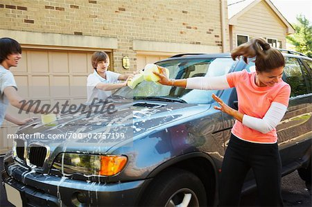 Woman with Teenage Sons Washing Car Stock Photo - Rights-Managed, Image code: 700-02757199