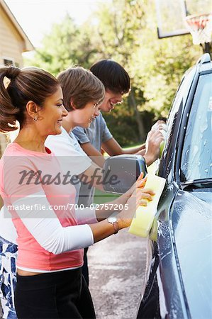 Mother and Teenage Sons Washing Car Stock Photo - Rights-Managed, Image code: 700-02757205