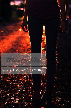 Silhouette of Woman Standing Outdoors at Dusk Stock Photo - Rights-Managed, Image code: 700-02786842