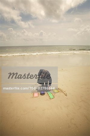 Businessman Drawing Chart in the Sand on the Beach, Savannah, Georgia, USA Stock Photo - Rights-Managed, Image code: 700-02786844