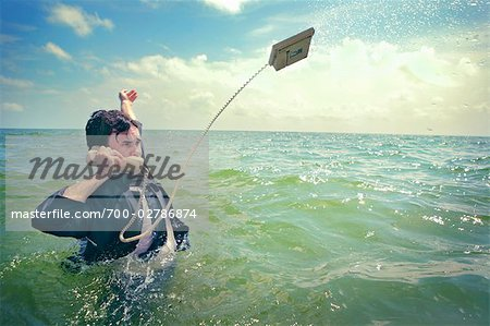 Businessman in the Ocean Talking on Telephone Stock Photo - Rights-Managed, Image code: 700-02786874
