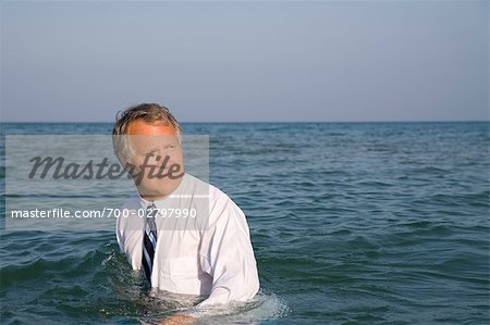 Businessman in the Ocean
