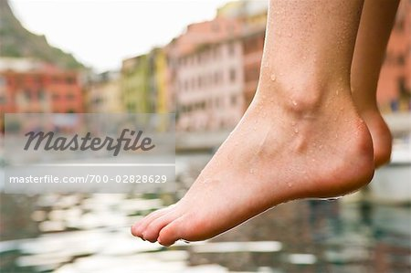 Woman Dipping Her Feet in Water, Near Beach in Vernazza, Liguria, Italy Stock Photo - Rights-Managed, Image code: 700-02828629