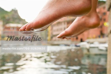 Woman Dipping Her Feet in Water, Near Beach in Vernazza, Liguria, Italy Stock Photo - Rights-Managed, Image code: 700-02828630