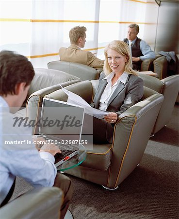 Business People Waiting in Airport Lounge Stock Photo - Rights-Managed, Image code: 700-02887159