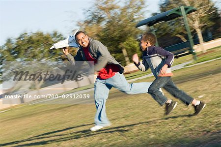 Father and Son Playing With Toy Shuttle in the Park Stock Photo - Rights-Managed, Image code: 700-02912039