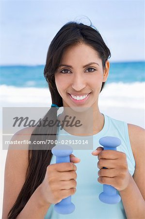 Woman Holding Dumbbells Stock Photo - Rights-Managed, Image code: 700-02913014