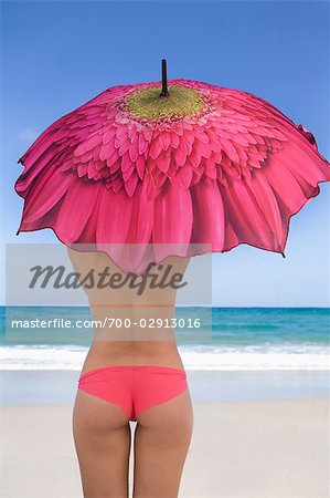 Woman on the Beach Holding an Umbrella Stock Photo - Rights-Managed, Image code: 700-02913016