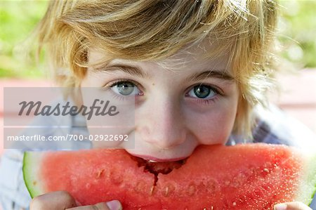Boy Eating Watermelon Stock Photo - Rights-Managed, Image code: 700-02922692