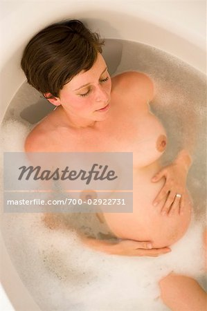Pregnant Woman Relaxing in the Bathtub Stock Photo - Rights-Managed, Image code: 700-02922731