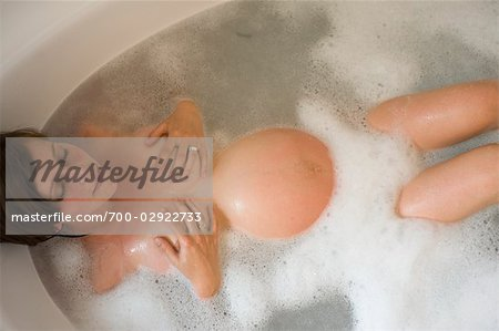 Pregnant Woman Relaxing in the Bathtub Stock Photo - Rights-Managed, Image code: 700-02922733