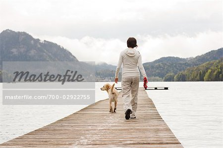 Pregnant Woman Walking on Dock With Her Dog Stock Photo - Rights-Managed, Image code: 700-02922755