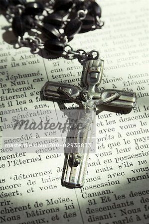 Close-up of Crucifix Laying on French Language Bible Stock Photo - Rights-Managed, Image code: 700-02935833