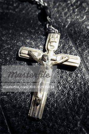 Close-up of Crucifix Laying on Bible Stock Photo - Rights-Managed, Image code: 700-02935834