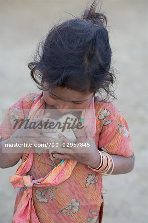 Little Girl Holding Chick, Chapagaon, Nepal Stock Photo - Rights-Managed, Image code: 700-02957845